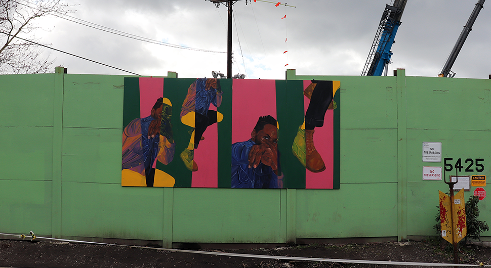 Rectangular blocks in different colors contain images of a black individual in a jean jacket pointing. Each block is colored pink and turquoise and contains fragmented images of the individual .