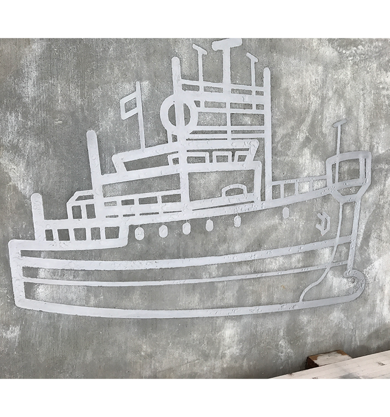 An image of a fishing boat made up of steel embedded into concrete.