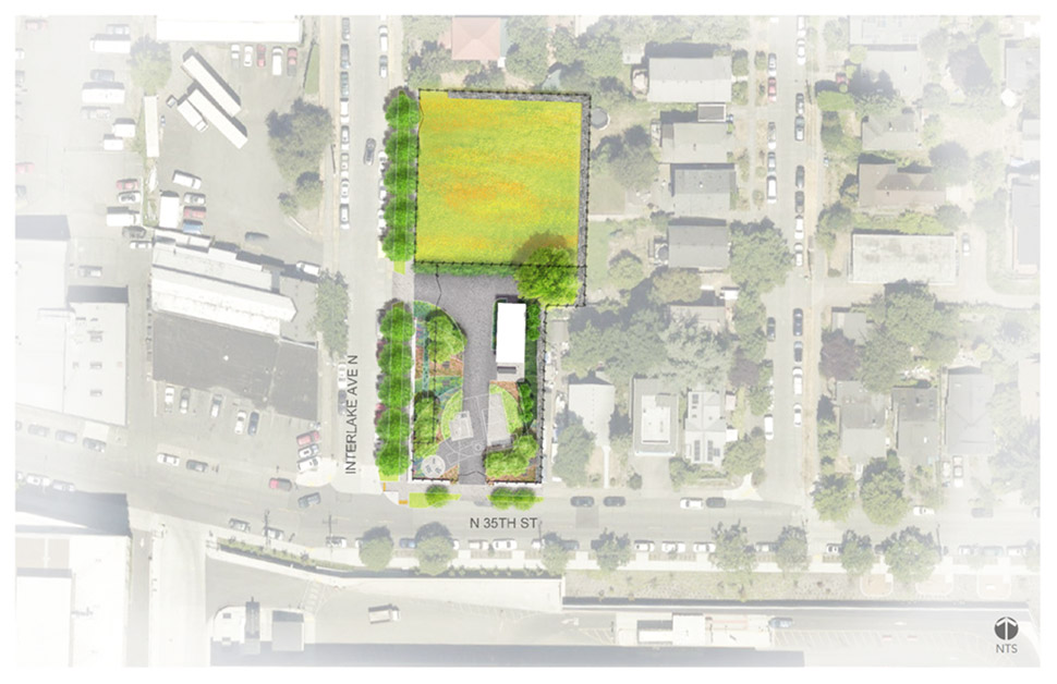 An aerial landscape rendering that depicts the future Wallingford site. A black fence surrounds vegetation and buildings. The street to the left of the rendering is Interlake Avenue North and the street below the rendering is North thirty-fifth Street.